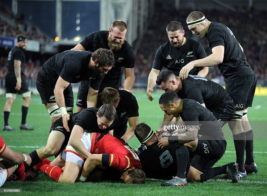 The New Zealand All Blacks celebrate the try of <a gi-track='captionPersonalityLinkClicked' href=/galleries/search?phrase=Beauden+Barrett&family=editorial&specificpeople=7264286 ng-click='$event.stopPropagation()'>Beauden Barrett</a> during the International Test match between the New Zealand All Blacks and Wales at Forsyth Barr Stadium on June 25, 2016 in Dunedin, New Zealand.
