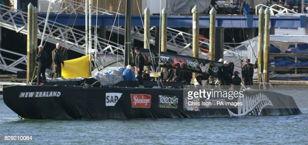 The New Zealand America's Cup yacht returns to 'Syndicate Row' in Auckland's Viaduct Harbour shrouded by a cloth skirt to hide its keel and rudder...