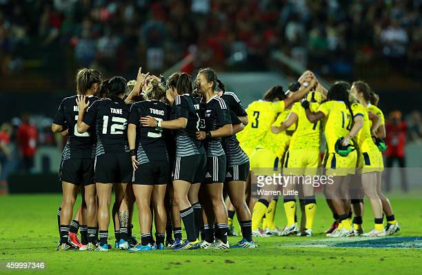 The New Zealand and Australian teams huddle ahaead of the Emirates Dubai Sevens IRB Women's Sevens World Series Cup Final on December 5 2014 in Dubai...