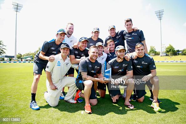 The New Zealand Blackcaps pose with the series winning trophy following day four of the Second Test match between New Zealand and Sri Lanka at Seddon...