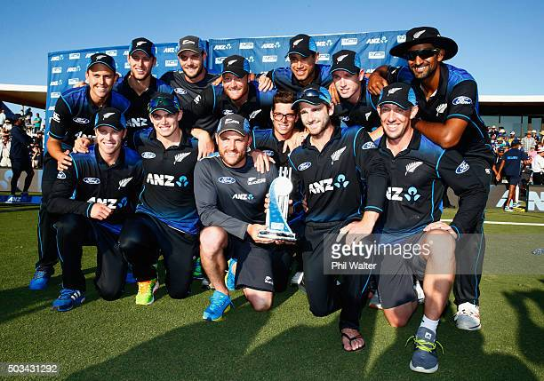 The New Zealand Blackcaps pose with the winning trophy following game five of the One Day International series between New Zealand and Sri Lanka at...