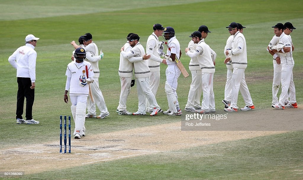 The New Zealand congratulate each other after defeating Sri Lanka on day five of the First Test match between New Zealand and Sri Lanka at University...