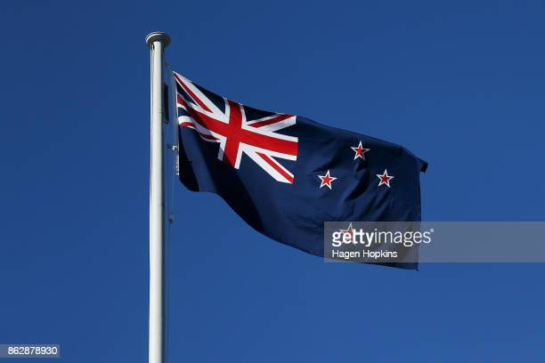 The New Zealand flag flies on top of Parliament House prior to a NZ First announcement at Parliament on October 19 2017 in Wellington New Zealand...