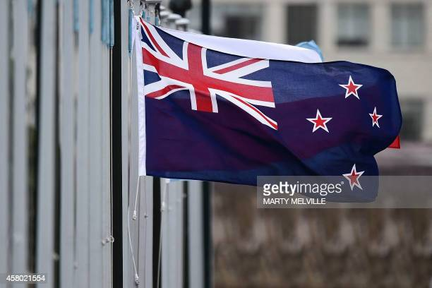 The New Zealand flag flutters outside Parliament buildings in Wellington in Wellington on October 29 2014 New Zealand will hold a binding referendum...