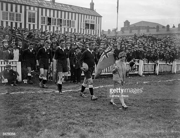 The New Zealand rugby league team the 'Kiwis' arrive on the field with their mascot for a test match against England at Wigan