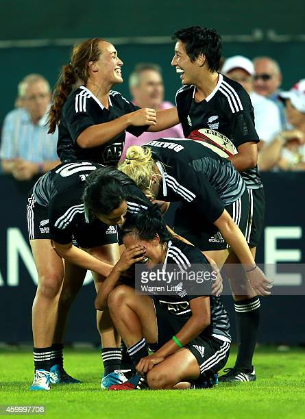 The New Zealand team celebrate beating Australia to win the IRB Women's Sevens World Series Cup Final on December 5 2014 in Dubai United Arab Emirates