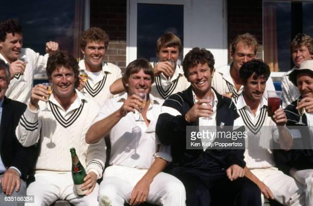 The New Zealand team celebrate their first Test win over England in England with a glass of champagne at the end of the 2nd Test match between...