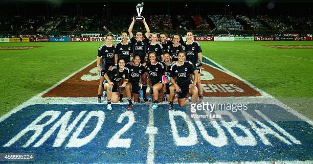 The New Zealand team celebrate with the trophy after winning the IRB Women's Sevens World Series Cup Final on December 5 2014 in Dubai United Arab...