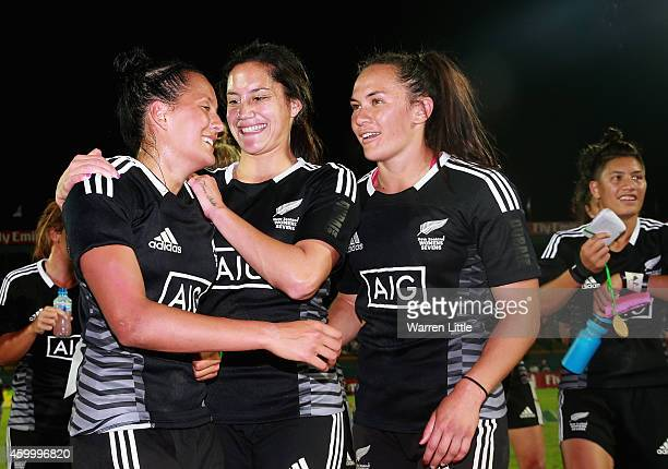The New Zealand team celebrates after beating Australia to win the Emirates Dubai Sevens IRB Women's Sevens World Series Cup Final on December 5 2014...