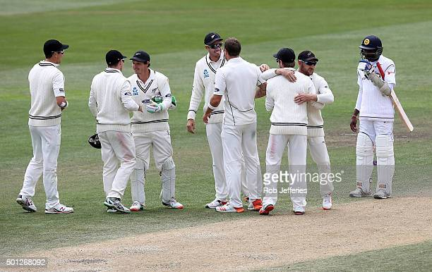 The New Zealand team congratulate each other after defeating Sri Lanka on day five of the First Test match between New Zealand and Sri Lanka at...