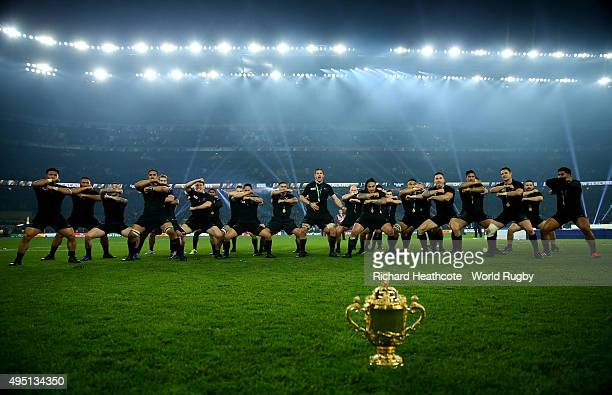 The New Zealand team perform the Haka behind the Webb Ellis Cup to celebrate winning the 2015 Rugby World Cup Final match between New Zealand and...
