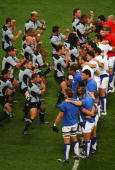 The New Zealand team perform The Haka whilst confronted by the France team wearing shirts representing the national flag before the Quarter Final of...