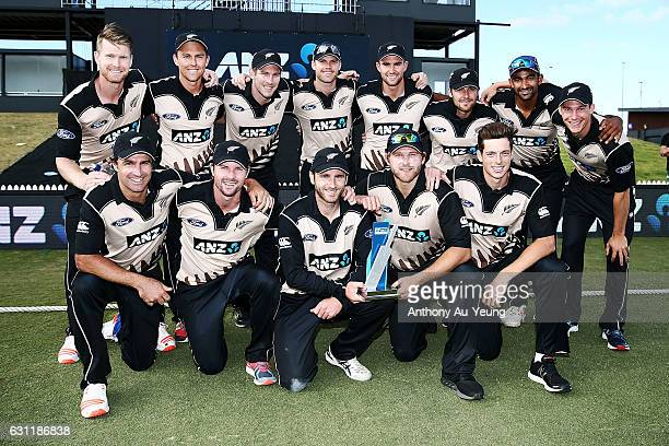 The New Zealand team pose for a photo with the series trophy after winning the third Twenty20 International match between New Zealand and Bangladesh...