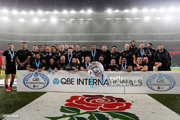 The New Zealand team pose with the trophy after the QBE International match between England and New Zealand at Twickenham Stadium on November 8 2014...