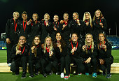The New Zealand team pose with their Bronze Medals after winning the Bronze Medal in the Women's Bronze Medal Final match between New Zealand and...