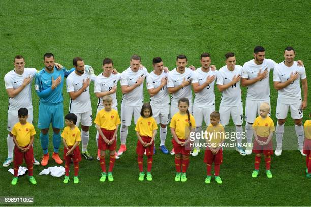 The New Zealand team sing their national anthem at the start of the 2017 Confederations Cup group A football match between Russia and New Zealand at...