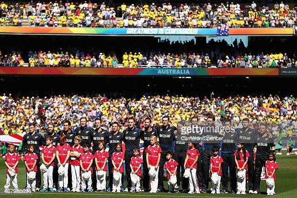 The New Zealand team sing their national anthem during the 2015 ICC Cricket World Cup final match between Australia and New Zealand at Melbourne...