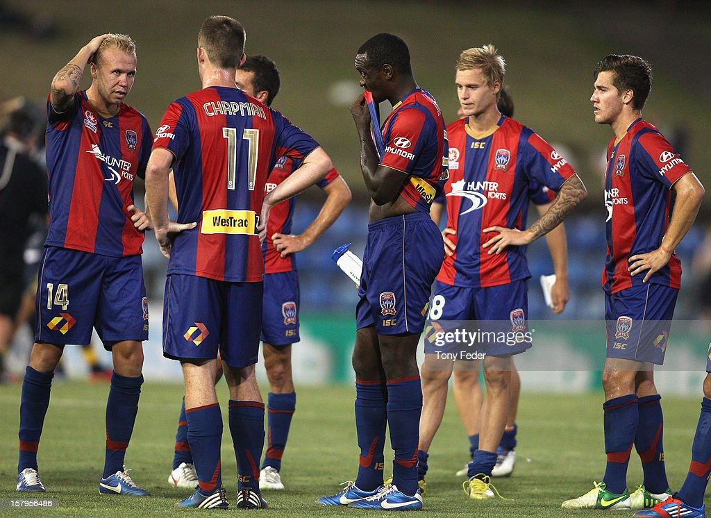 The Newcastle Jets look dejected after losing to the Mariners during the round ten A-League match between the Newcastle Jets and the Central Coast Mariners at Hunter Stadium on December 8, 2012 in Newcastle, Australia.