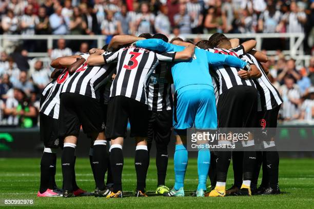 The Newcastle players form a huddle prior to the Premier League match between Newcastle United and Tottenham Hotspur at St James' Park on August 13...