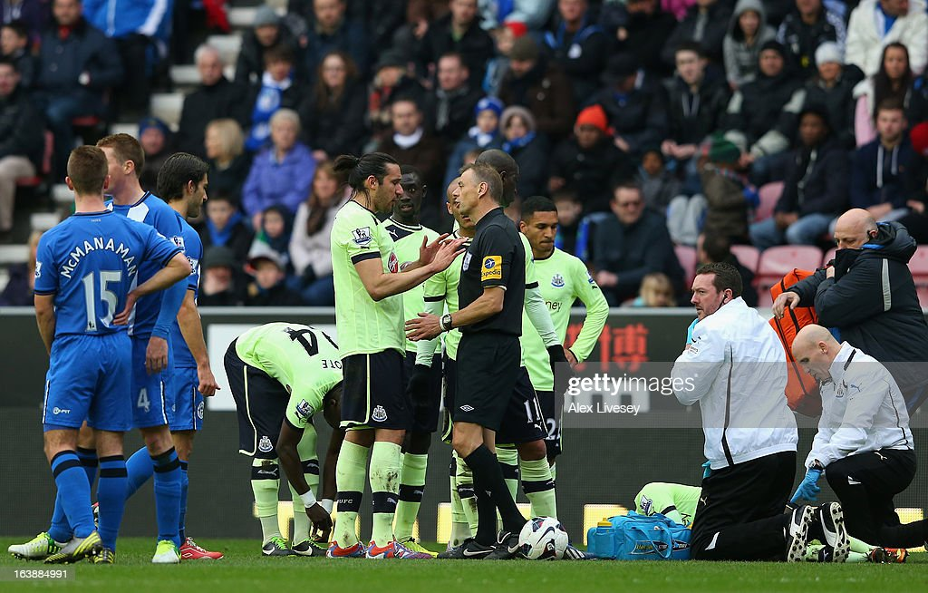 The Newcastle players protest to Referee Mark Halsey following a challenge by Callum McManaman of Wigan Athletic on Massadio Haidara of Newcastle United during the Barclays Premier League match between Wigan Athletic and Newcastle United at the DW Stadium on March 17, 2013 in Wigan, England.