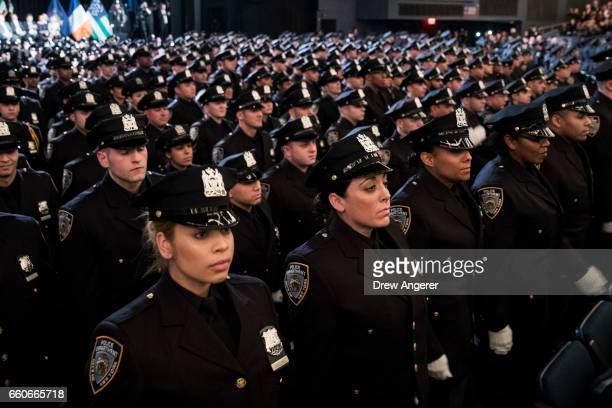 The newest members of the New York City Police Department attend their police academy graduation ceremony at the Theater at Madison Square Garden...