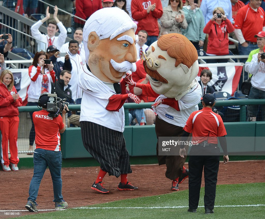 The newest president mascot at Nationals Park, William H. Taft, or 'Bill' for short, tussles with the Teddy Roosevelt mascot during the break in the fourth inning at Nationals Park in Washington, D.C., Monday, April 1, 2013. The Washington Nationals defeated the Miami Marlins, 2-0.