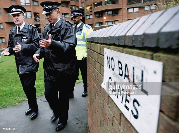 The Newly appointed Commissioner of the Metropolitan Police Sir Ian Blair and Sgt Phil Murray walk a housing estate in Chelsea on February 1 2005 in...