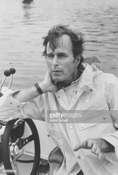 The newly appointed envoy to China George Bush leaning on the steering wheel of his motor boat