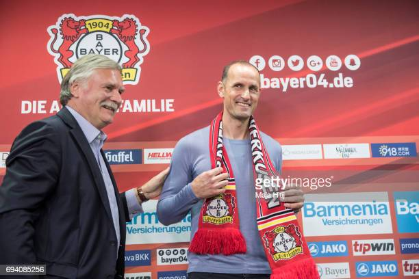 The newly appointed head coach Heiko Herrlich and chairman Michael Schade smile after a press conference at BayArena on June 9 2017 in Leverkusen...
