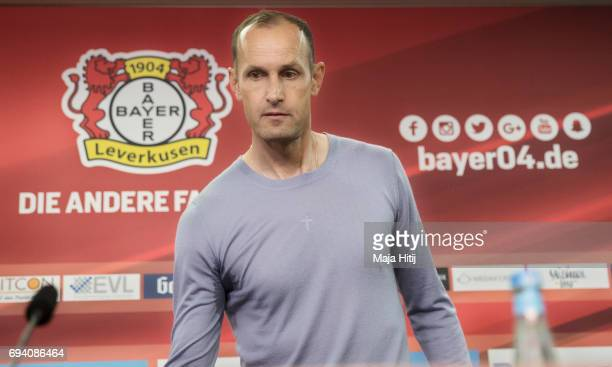 The newly appointed head coach of Bayer Leverkusen Heiko Herrlich arrives to a press conference at BayArena on June 9 2017 in Leverkusen Germany