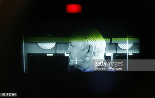 The newly appointed Home Secretary John Reid is shown through a video camera as he meets the team hunting down foreign criminals who were released...