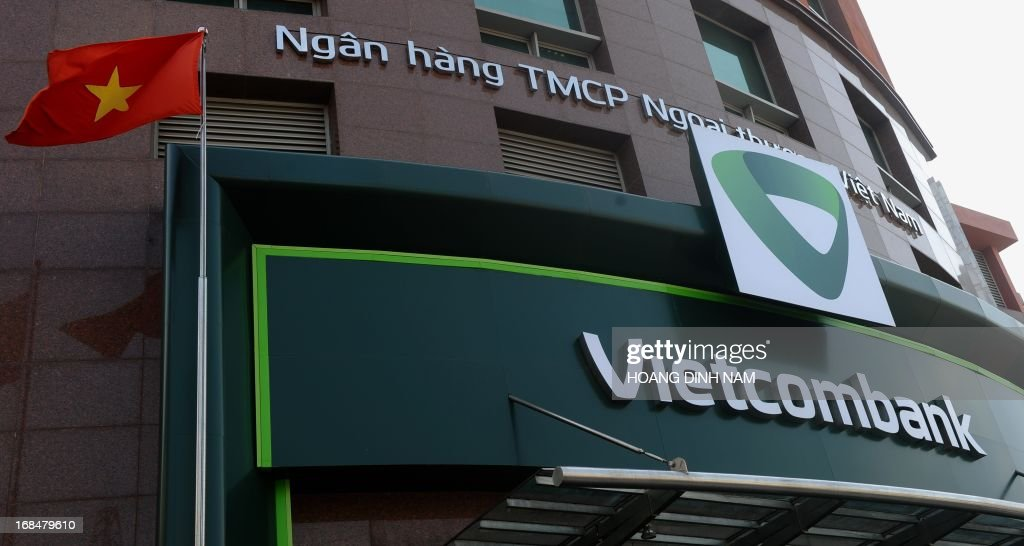 The newly changed official logo of the local commercial bank Bank for Foreign Trade of Vietnam (Vietcombank) is seen on the facade of the bank's headquarters office in Hanoi on May 10, 2013. Vietnam will cut interest rates for the eighth time in more than a year, hoping to improve the weakening economy, the central bank said on May 10. AFP PHOTO/HOANG DINH Nam.