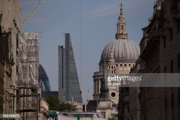 The newly constructed skyscraper The Leadenhall Building stands on the London skyline next to the dome of St Paul's Cathedral on September 15 2014 in...