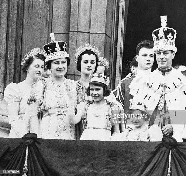 The newly coronated King George VI and his family greet their subjects from a balcony of Buckingham Palace