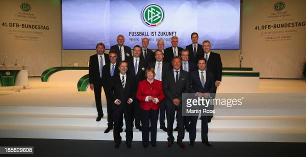The newly elected DFB executive board poses for a photo after the DFB Bundestag Day 2 at NCC Nuremberg on October 25 2013 in Nuremberg Germany