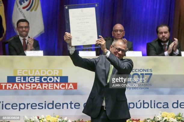 CORRECTION The newly elected Ecuadorean VicePresident Jorge Glas shows the document that recognizes him as vicepresident at the National Assemby in...