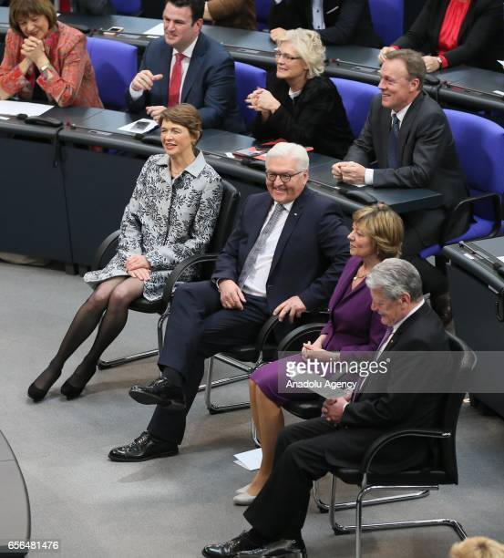The newly elected Germany State President FrankWalter Steinmeier and his wife Elke Buedenbender sit in between the outgoing German State President...