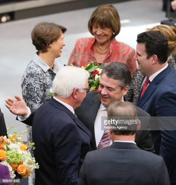The newly elected Germany State President FrankWalter Steinmeier his wife Elke Buedenbender outgoing German State President Joachim Gauck and his...