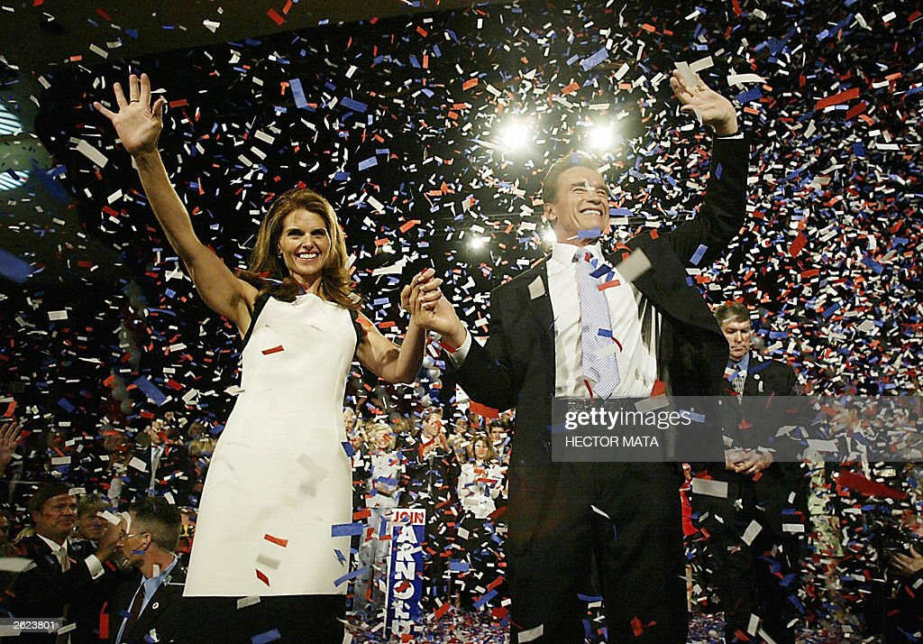 The newly elected Governor of California Arnold Schwarzenegge and his wife Maria Shriver waves to his supporters after delivering a victory speech at a party in Los Angeles, CA 07 Oct 2003.