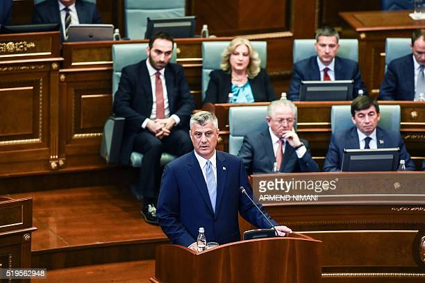 The newly elected Kosovo President Hashim Thaci addresses members of the parliament during the swearingin ceremony in Pristina on April 7 2016 Thaci...