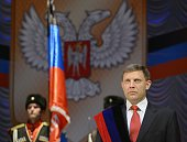 The newly elected leader of the selfproclaimed Donetsk People's Republic Alexander Zakharchenko takes the oath on November 4 2014 during an...