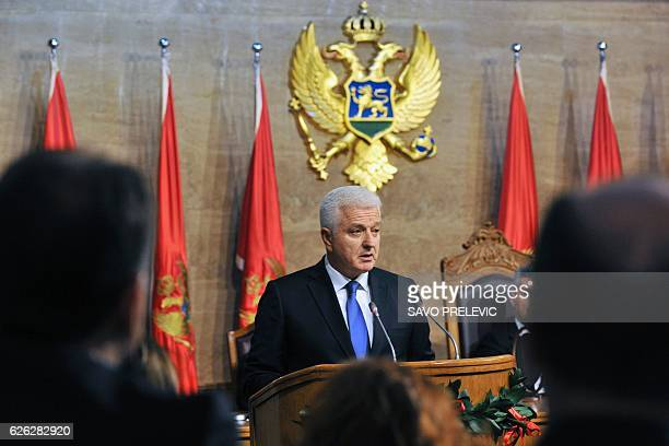 The newly elected Montenegrin Prime Minister Dusko Markovic delivers a speech during a ceremony at the Montenegro Parliament in Podgorica on November...