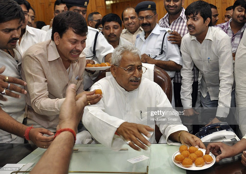 The newly elected Vidhan Sabha speaker Mata Prasad Pandey is offered sweets April 13, 2012 in Lucknow, India. Mata Prasad Pandey is the Samajwadi Party MLA from Itwa seat. This will be his second time as speaker of house.