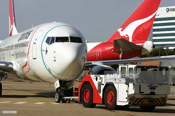 The newly unveiled Qantas Melbourne 2006 Commonwealth Games 737800 is taken to a hangar at Sydney airport after its maiden flight from Melbourne 31...