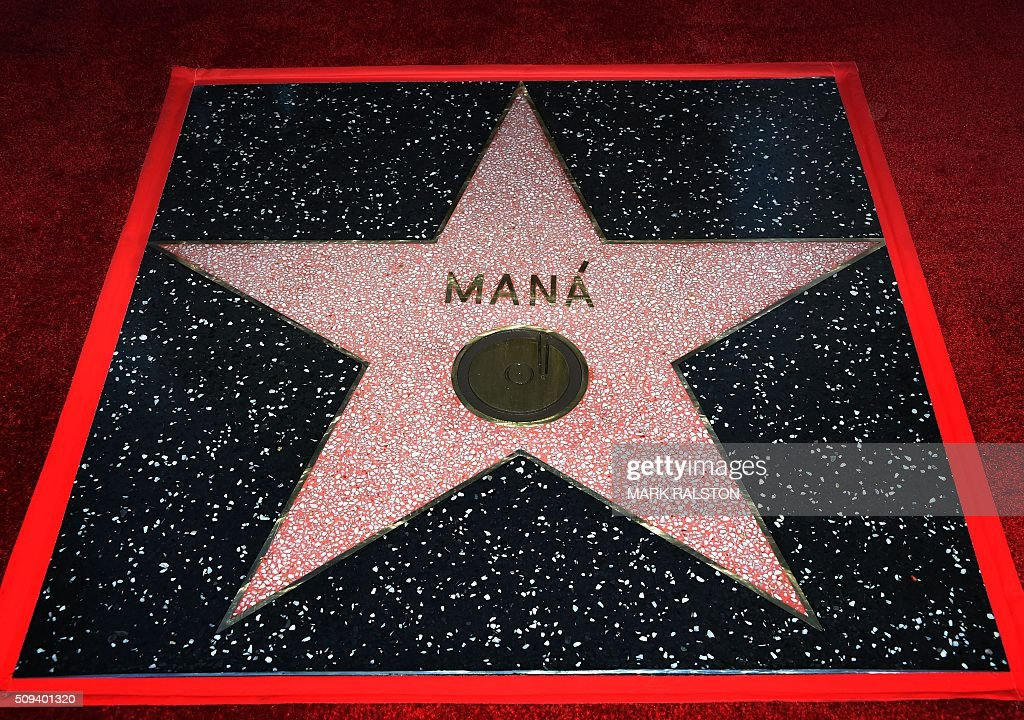 The newly unveiled star for the rock band 'Mana' after members Alex Gonzalez, Sergio Vallin, Juan Calleros and Fher Olvera attended the ceremony honoring them with the 2,573rd star on the Hollywood Walk of Fame in Hollywood, California on February 10, 2016. / AFP / Mark Ralston