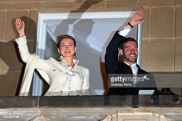 The newly wed couple Princess Stephanie of Luxembourg and Prince Guillaume of Luxembourg wave to the crowd after their wedding ceremony of Prince...