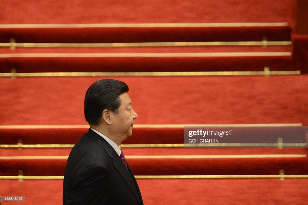 The newly-elected Chinese President Xi Jinping walks back to his seat after delivering his maiden speech at the closing session of the National People's Congress (NPC) at the Great Hall of the People in Beijing on March 17, 2013. China's newly-installed President Xi Jinping said he would fight for a 'great renaissance of the Chinese nation', in his first speech as head of state of the world's most populous country.