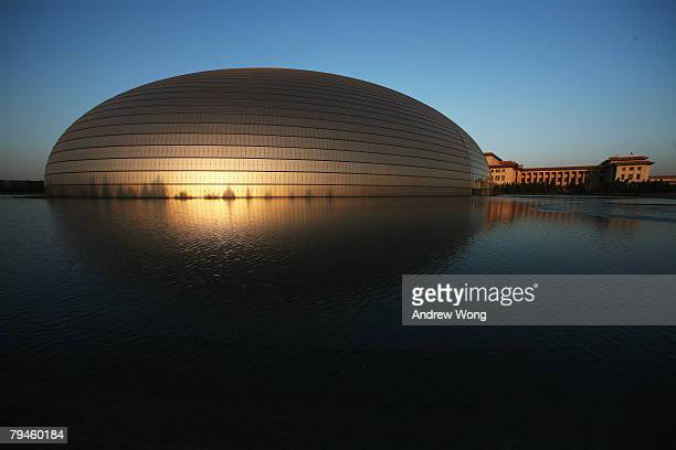 The newlyopened National Grand Theater sits in front of the Great Hall of the People on January 31 2008 in Beijing China Beijing will host Games of...