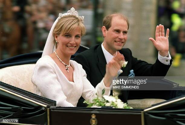 The newlywed British royal couple Prince Edward and Sophie RhysJones greet wellwishers on their way from Windsor Castle after the wedding ceremony 19...