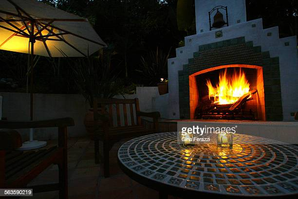 The Newman's outdoor fireplace makes a cozy seating area for their backyard patio in Hollywood